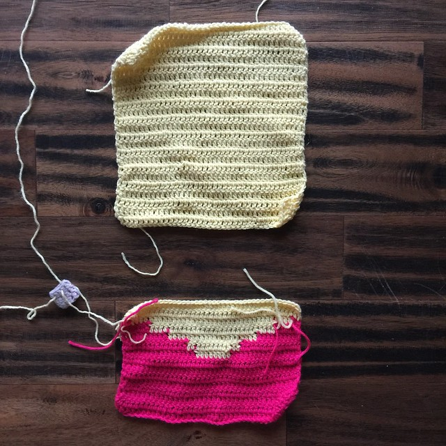 Two of the center squares of a nine square Valentine's Day yarn bomb worked in yellow and pink