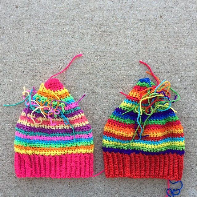 Two multi-color scrap buster hats with ends to be woven in.