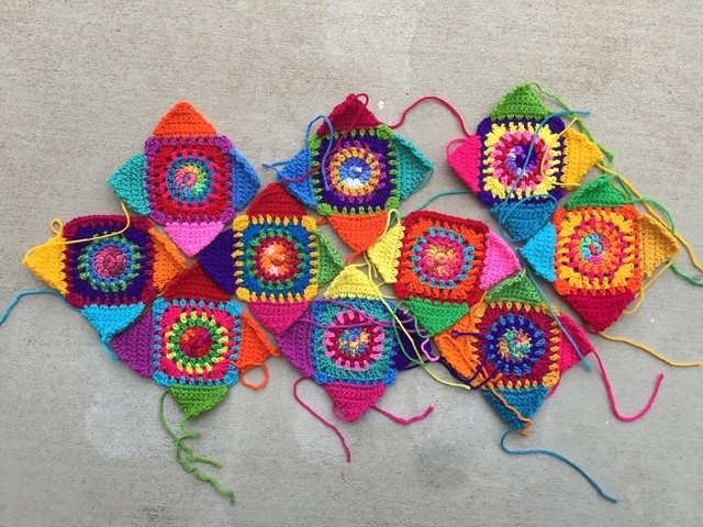 The ten almost completed Crochetachella squares made by following my obscure color rules