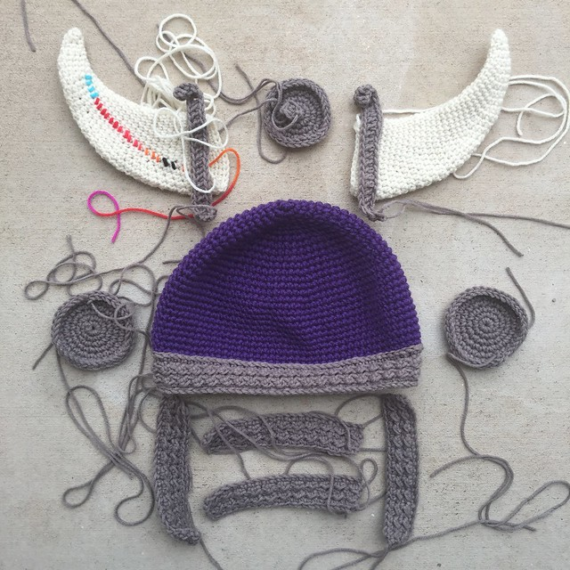 All of the pieces of a crochet Viking helmet