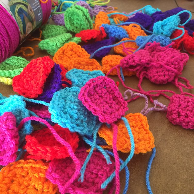 A rainbow of crochet pieces with ends to be woven in