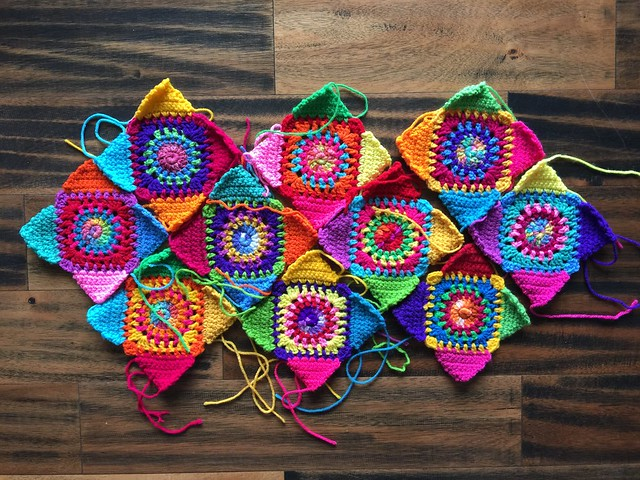 Ten multicolor crochet granny squares with ends to be woven in and trimmed