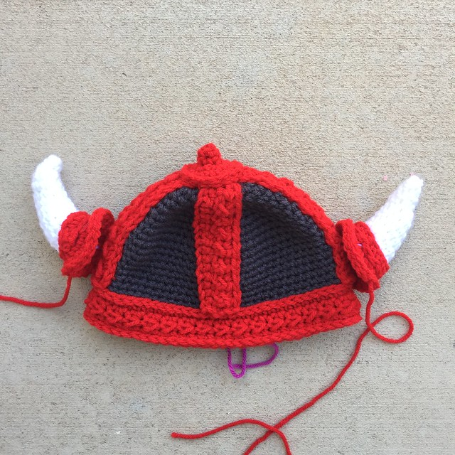 A crochet Viking hat for a baby after