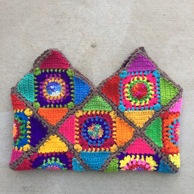 One side of the interior of the crochetachella purse with the ends woven in and trimmed