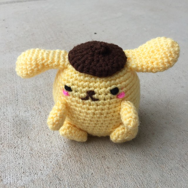 Purin the crochet golden retriever completed and ready for adventure