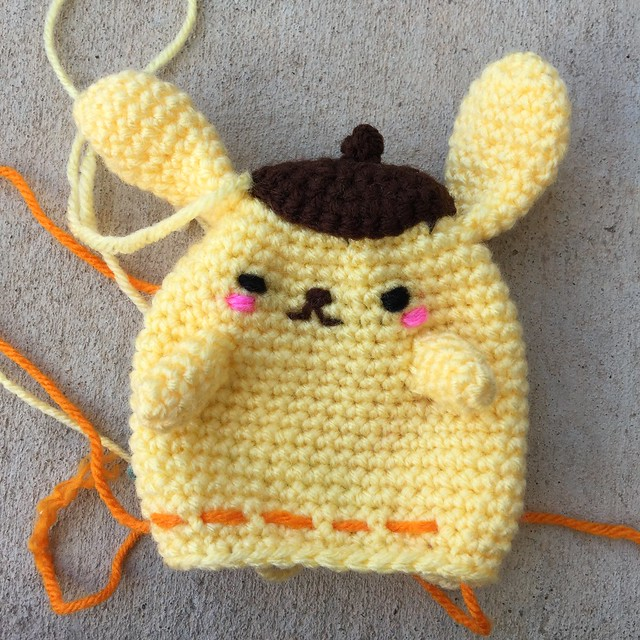 Purin with a strand of yarn running through to mark where to place his paws