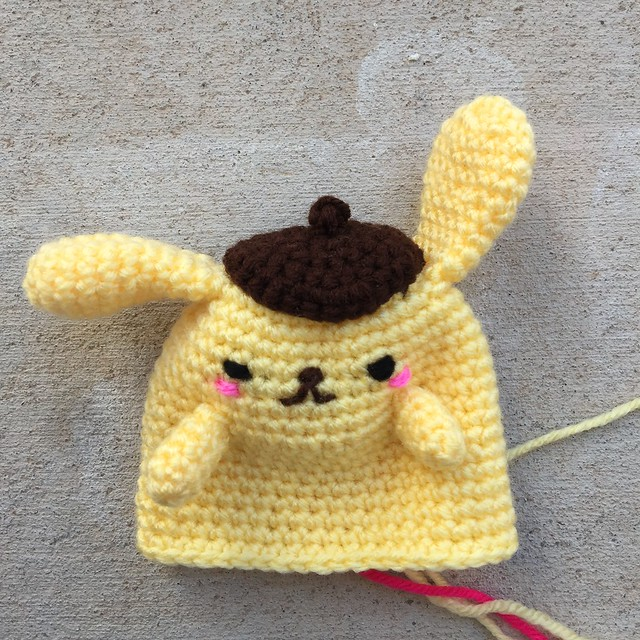Purin the crochet golden retriever with arms and all of his ends woven in