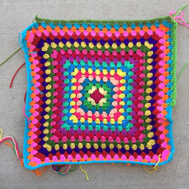 Choosing between two greens for the twentieth round of a granny square blanket