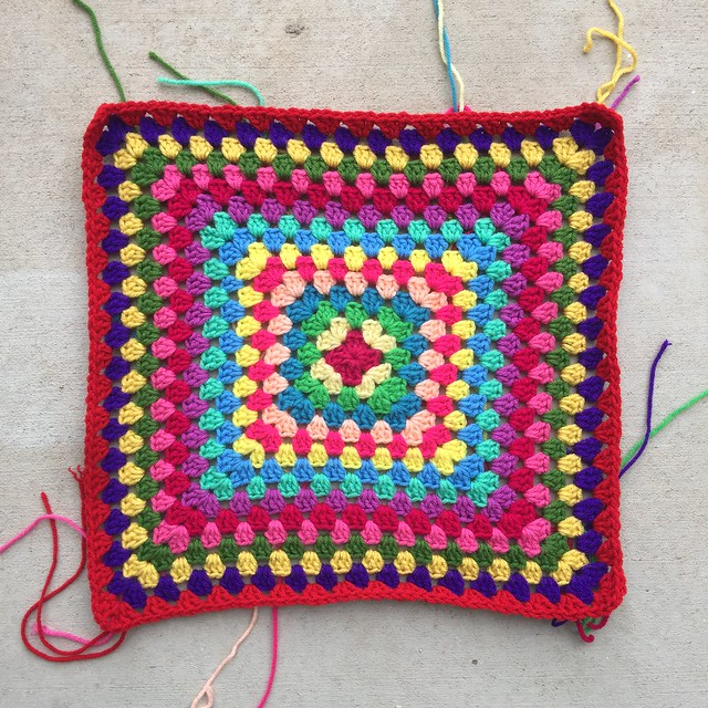 A sixteen round (so far) multicolor granny square blanket that sparks joy