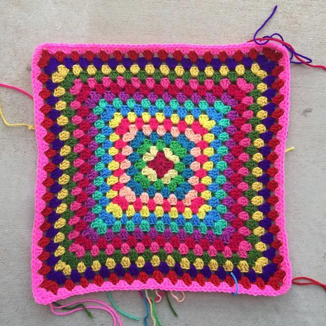 A multicolor granny square blanket