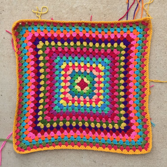 A round of saffron for the twenty-second round of a thirty-six round granny square blanket.