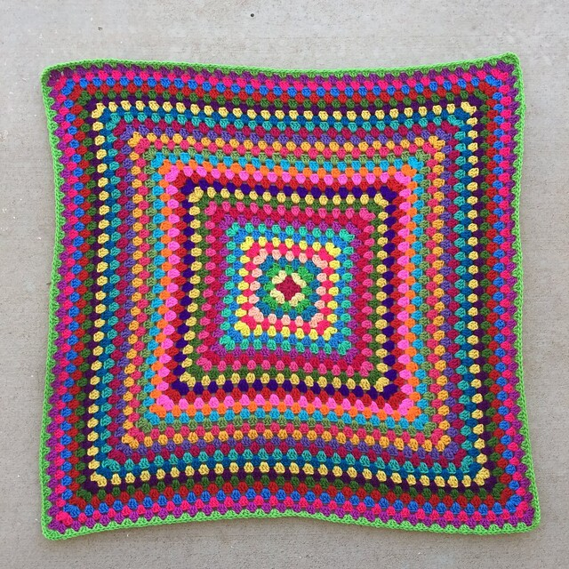 Thirty-four rounds of a great granny square multicolor crochet blanket