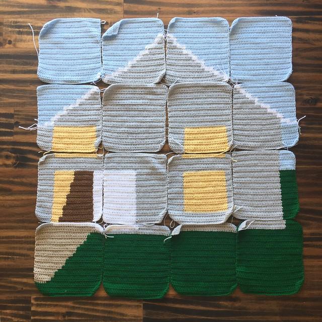 Sixteen double crochet panels of a yarn bomb
