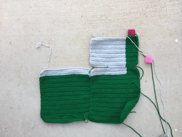 An emergent yarn bomb takes shape with the first three squares