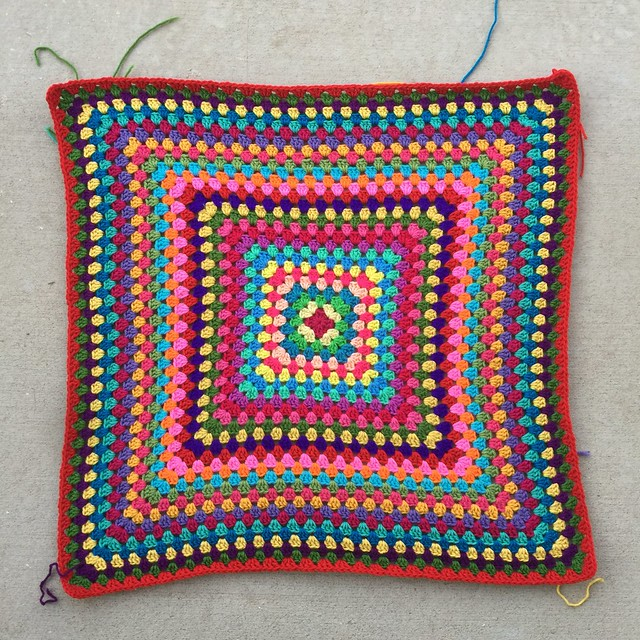 One more round of a great granny square multicolor crochet blanket bringing the total to thirty