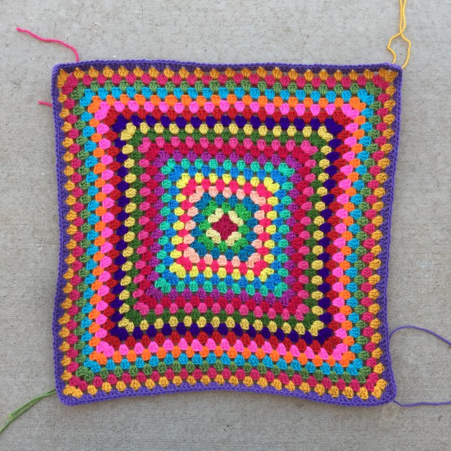 Twenty-three rounds of what will be a thirty-six round multicolor granny square blanket