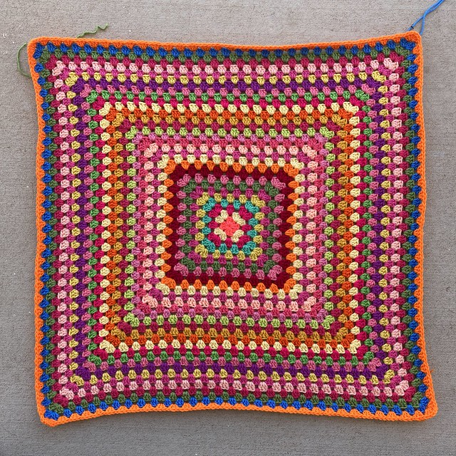 A thirty-one round multicolor crochet granny square