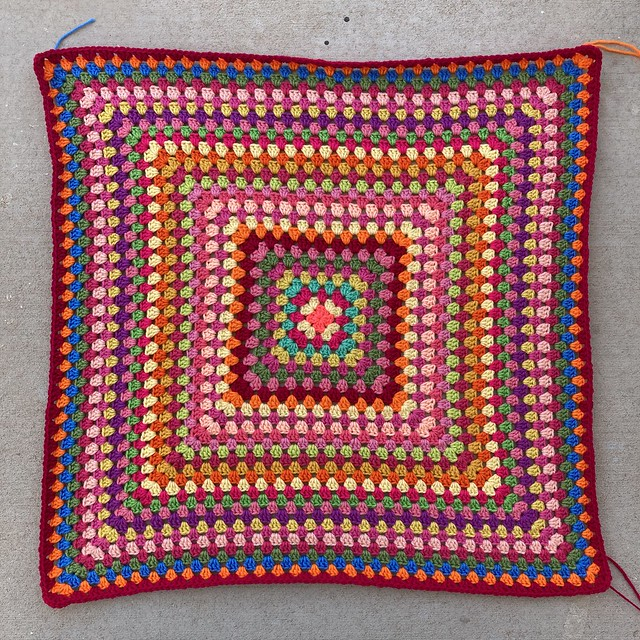 The first thirty-two rounds of a  multicolor crochet granny square