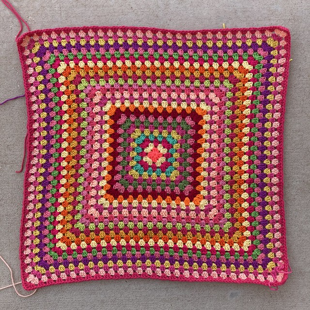 A twenty-eight round multicolor crochet granny square