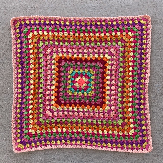 The twenty-seventh round shows the changing faces of a multicolor crochet granny square