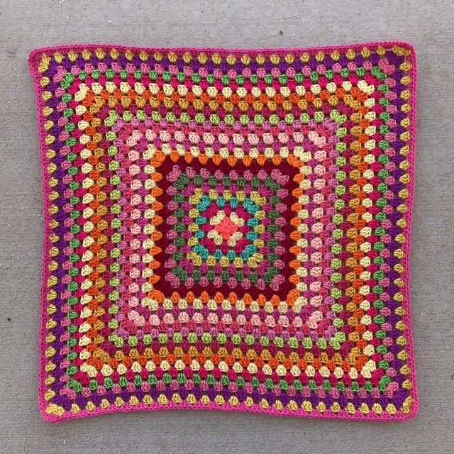 Round twenty-six of a multicolor crochet granny square blanket