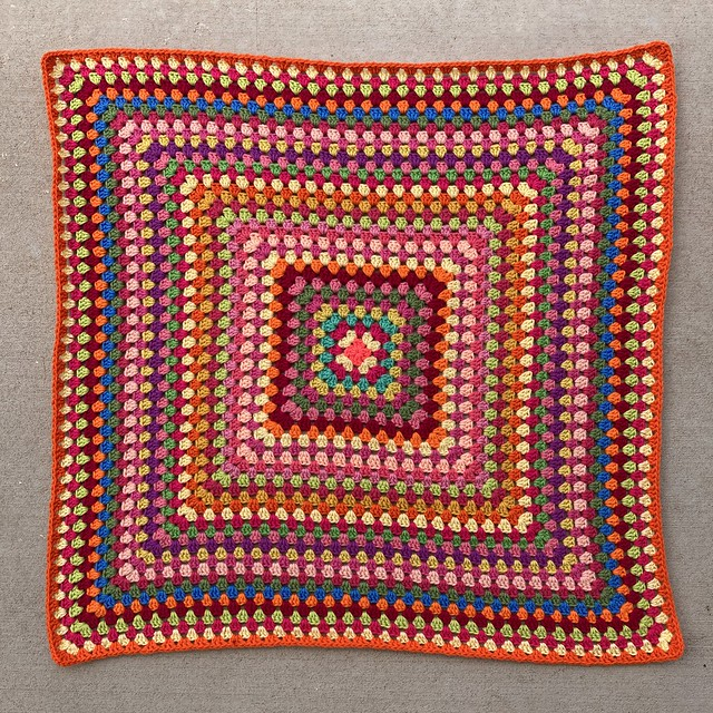 A thirty-six round multicolor crochet blanket made with a great granny square.