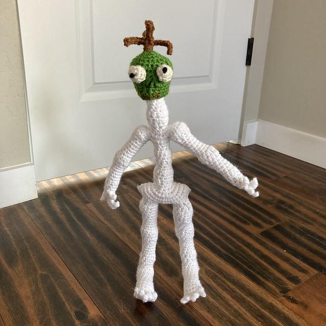 Mr. Headz the amigurumi skeleton wearing his shrunken head