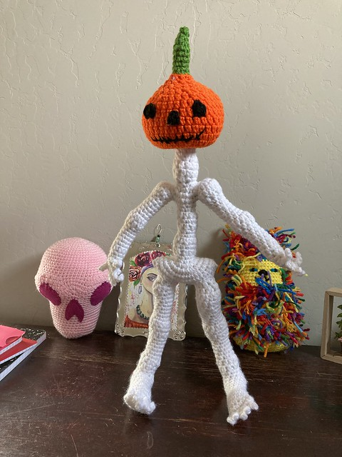 Mr. Bone Headz wearing his pumpkin head