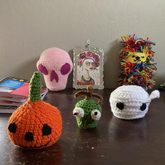 Three crochet heads for Mr. Bone Headz all in a row