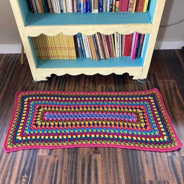 The finished multicolor crochet granny rectangle rug