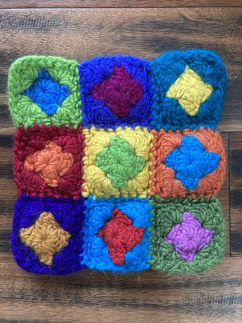 A felted crochet trivet made from granny squares