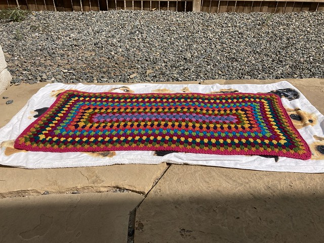 "A multicolor crochet granny rectangle rug getting some ""vitamin sunshine"""