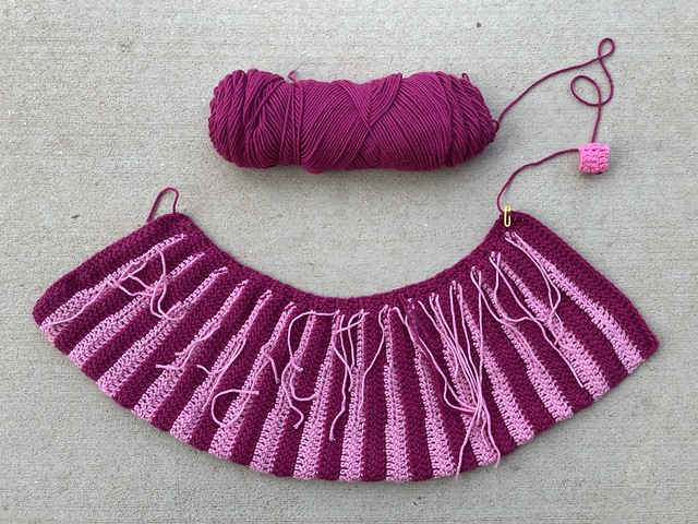 The back of the Eloise crochet sweater with ends to be woven in