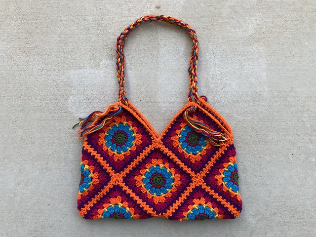 A finished granny square purse