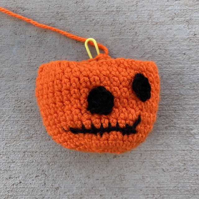 A crochet pumpkin head for 2020 Halloween