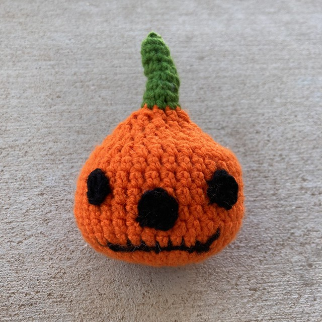 A crochet pumpkin head for a crochet skeleton
