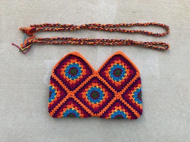 Two twisted yarn straps and the body of a granny square bag