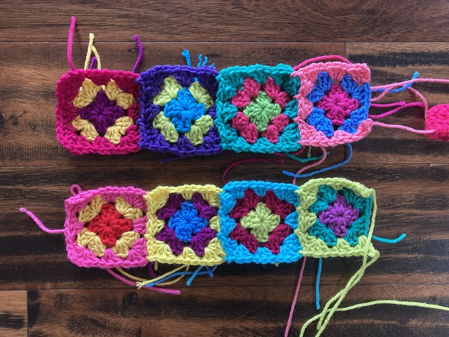 Eight three-round granny squares that emerged from a crochet impasse