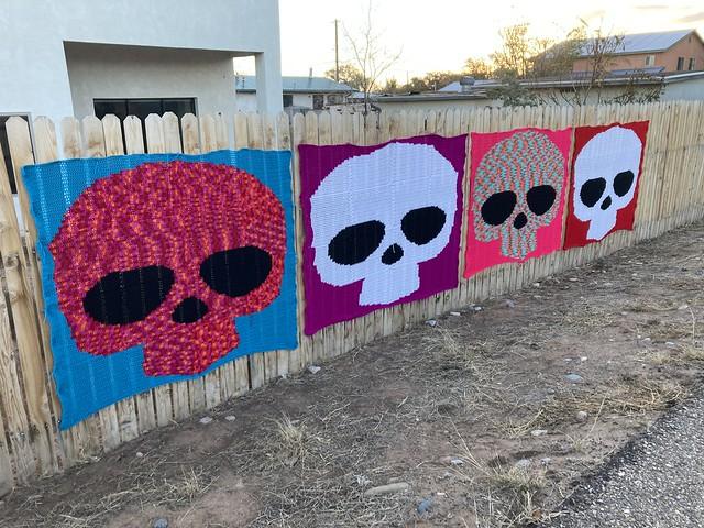 Four crochet sugar skulls all in a row